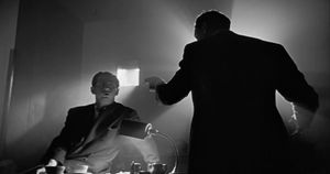 A film still from Citizen Kane that contains a lot of shadows with contrast.