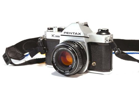 A 35mm film camera, specifically the Pentax K1000.